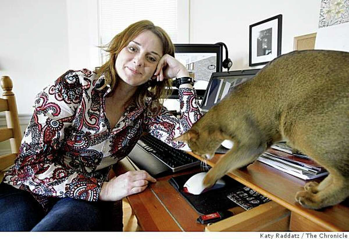 Geri Rebstock, posing for a portrait with her cat