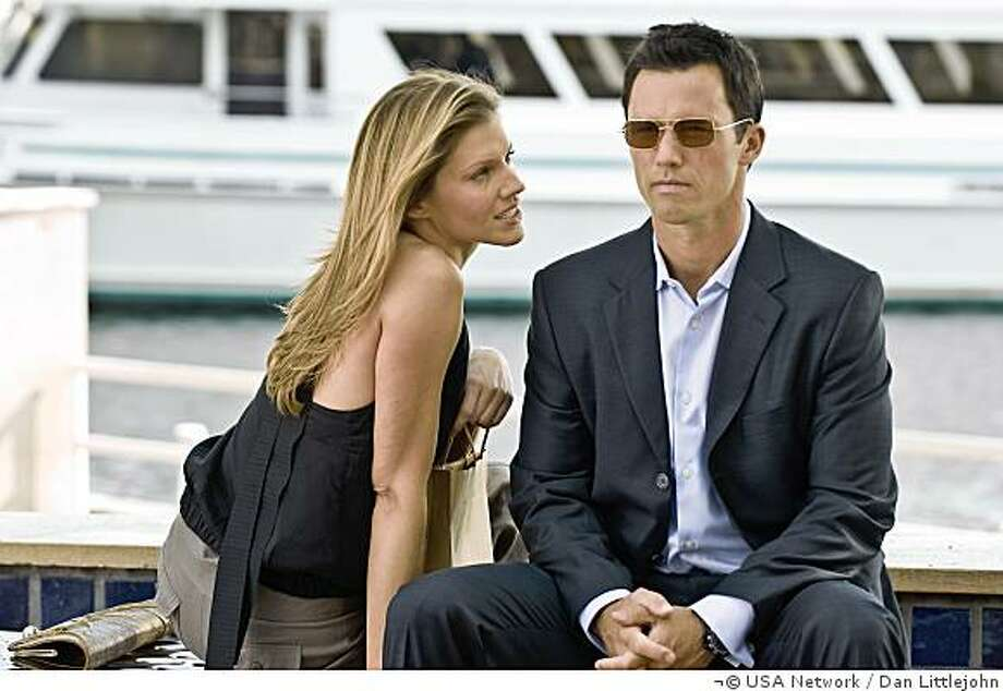 "BURN NOTICE -- ""Turn and Burn"" Episode 202 -- Pictured: (l-r) Tricia Helfer as Carla, Jeffrey Donovan as Michael Westen -- USA Network Photo: Dan Littlejohn Photo: Dan Littlejohn, �� USA Network"