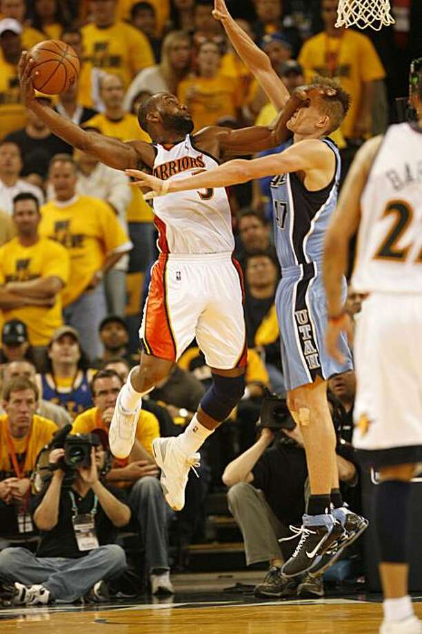 warrior_4qtr_game3_4942_KW.JPG  Golden State Warriors' Baron Davis dunks on Utah Jazz's Andrei Kirilenko during the fourth quarter of the Western Conference semi-finals at Oracle Arena in Oakland on Friday May 11, 2007.    Kat Wade/The Chronicle Photo: Kat Wade, The Chronicle
