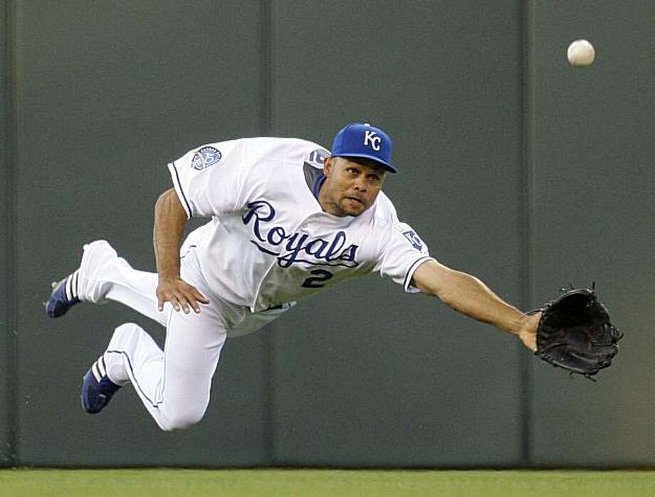 Kansas City Royals center fielder Coco Crisp dives for but misses an RBI single by Cleveland Indians' Matt LaPorta during the fourth inning of a baseball game, Tuesday, May 19, 2009, in Kansas City, Mo. (AP Photo/Charlie Riedel) Photo: Charlie Riedel, AP