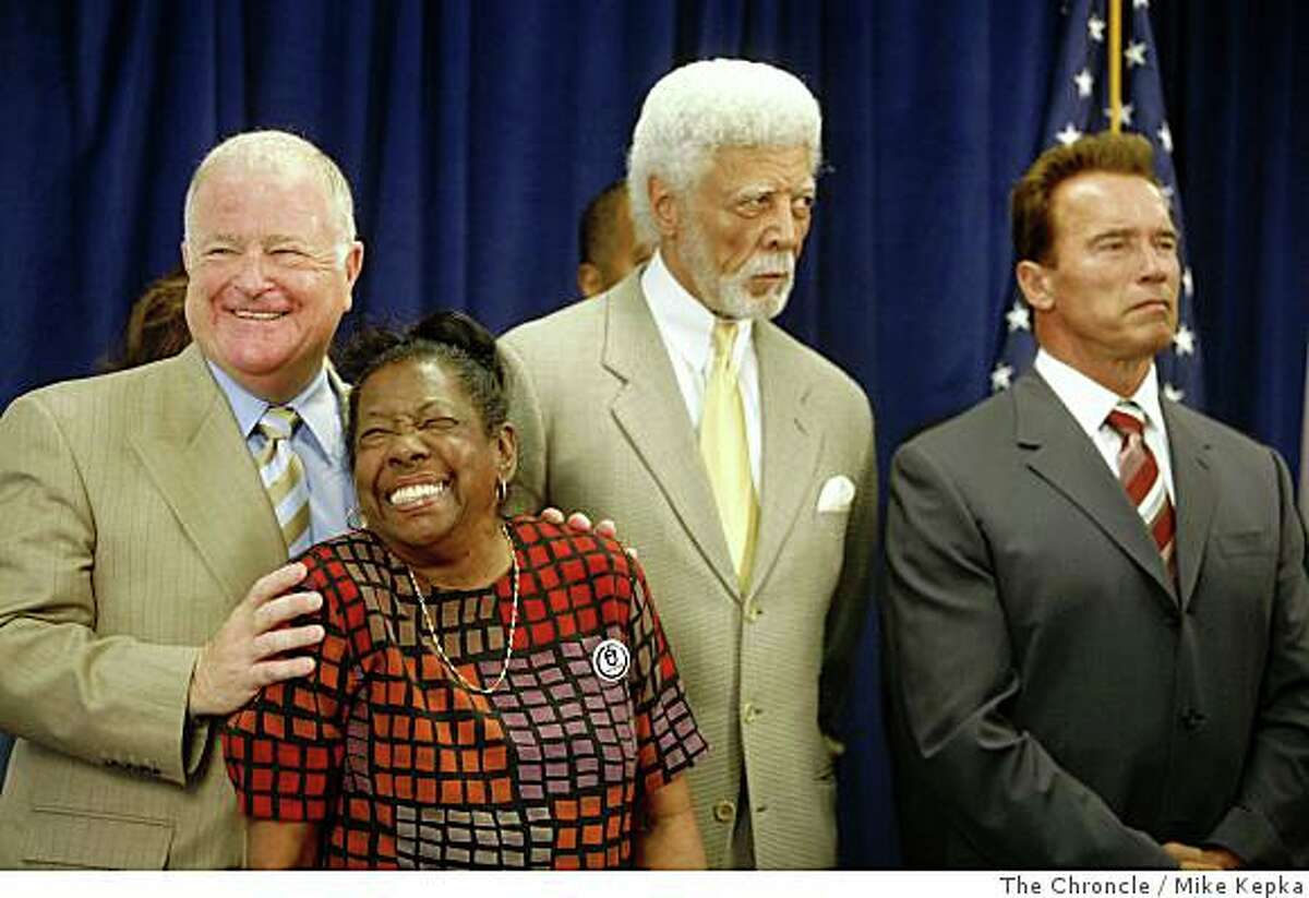 With Oakland's Mayor Ron Dellums and Governor Arnold Schwarzenegger to her right, Dorothy Hicks of Oakland receives a hug from Senate President pro Tem, Don Perata during a press conference at The Unity Council building on Tuesday July 8, 2008 in Oakland, Calif. where the governor later signed a foreclosure bill called SB1137. Hicks who's home was in foreclosure over a year ago pleaded her case in front of the state senate in Sacramento which kick started Perata's foreclosure bill. Photo by Mike Kepka / The Chronicle
