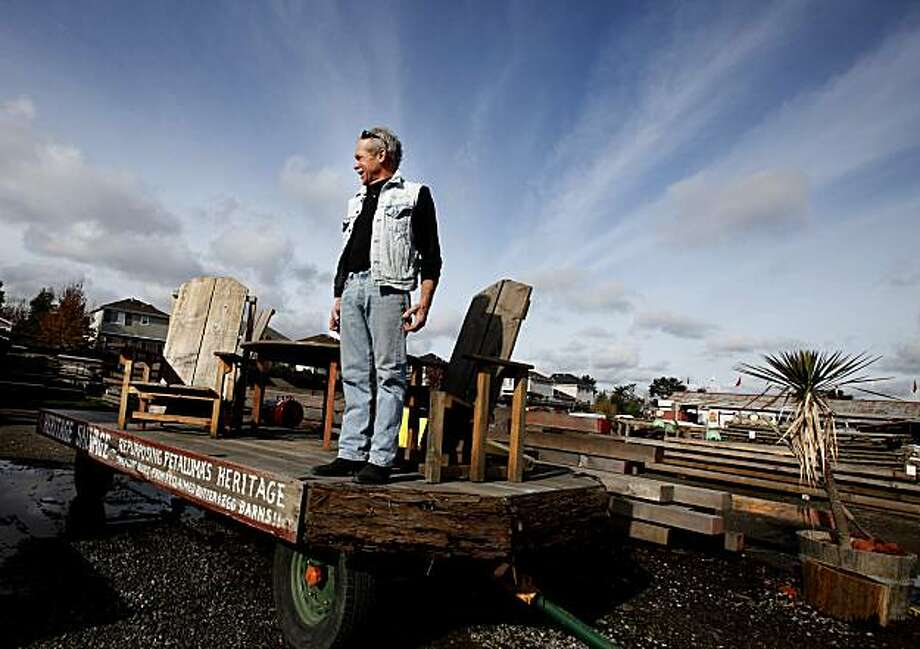 """Bug"" Deakin in the middle of his used paradise. Heritage Salvage in Petaluma, CA boasts three acres of recycled woods and building materials.  It is owned by Michael ""Bug"" Deakin who also sells finished furniture made from recycled materials. Photo: Brant Ward, The Chronicle"