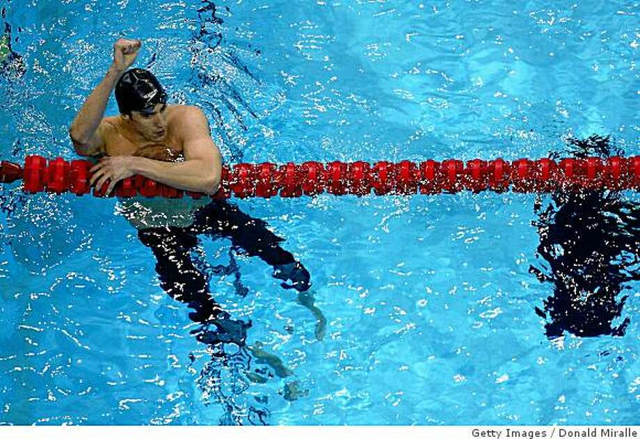 OMAHA, NE - JULY 04:  Michael Phelps celebrates after winning the final of the 200 meter individual medley and setting a new world record of 1:54.80 during the U.S. Swimming Olympic Trials on July 4, 2008 at the Qwest Center in Omaha, Nebraska.  (Photo by Donald Miralle/Getty Images) Photo: Getty Images