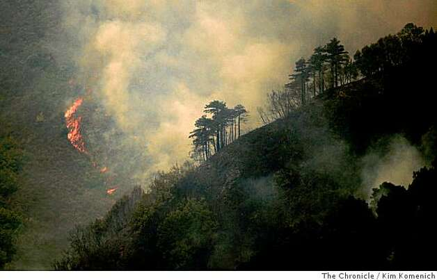 Flames burn up a slope near the Ventana Inn and Spa as the Basin Complex fire continues to burn in and around Big Sur, Calif., on Thursday, July 3, 2008 Photo by Kim Komenich / The Chronicle Photo: Kim Komenich, The Chronicle
