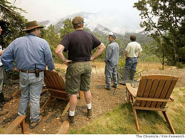 Stan Russell, left, and Butch Kronlund keep a watch on the Basin Complex fire from their makeshift command center at the home of Dan Priano at Post Ranch in Big Sur, Calif., on Thursday, July 3, 2008 Photo by Kim Komenich / The Chronicle Photo: Kim Komenich, The Chronicle