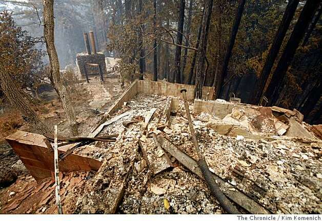 One of the three homes burned on early Thursday, July 3, 2008 by the Basin Complex fire smolders on a private dirt road adjacent to the Ventana Inn and Spa fire in Big Sur, Calif.Photo by Kim Komenich / The Chronicle Photo: Kim Komenich, The Chronicle