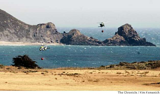 Helicopters use the Pacific Ocean near Andrew Molera State Park as a water supply for their air attack against the Basin Complex fire which continues to burn at Big Sur, Calif., on Thursday, July 3, 2008 Photo by Kim Komenich / The Chronicle Photo: Kim Komenich, The Chronicle