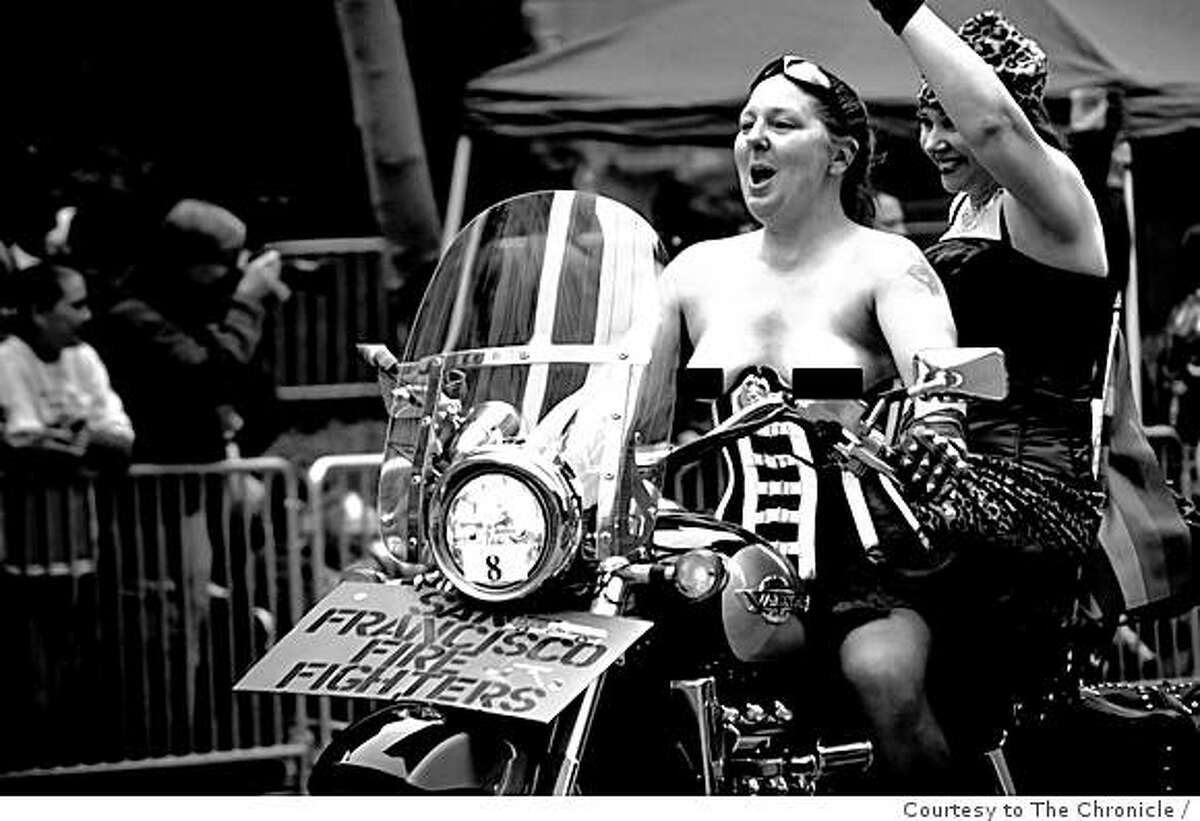 This photo, sent to the Chronicle anonymously, shows San Francisco fire Department firefighter Sabine Balden of Dykes on Bikes riding topless at the SF Gay Pride Parade. The image has been digitally altered for publication.
