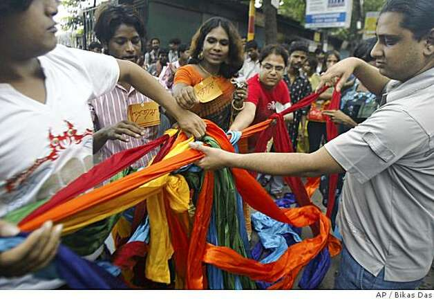 "Representatives of lesbian, gay, bisexual and transgender community unfurl a rainbow colored cloth during a ""Rainbow Pride Walk"" in Calcutta, India, Sunday, June 29, 2008. Hundreds of gay activists are estimated to march in Calcutta, Bangalore and New Delhi with rainbow flags and banners calling for an end to discrimination and pushing for acceptance in a society Sunday in the largest display of gay pride in the deeply conservative country where homosexuality is illegal, organizers said. (AP Photo/Bikas Das) Photo: Bikas Das, AP"