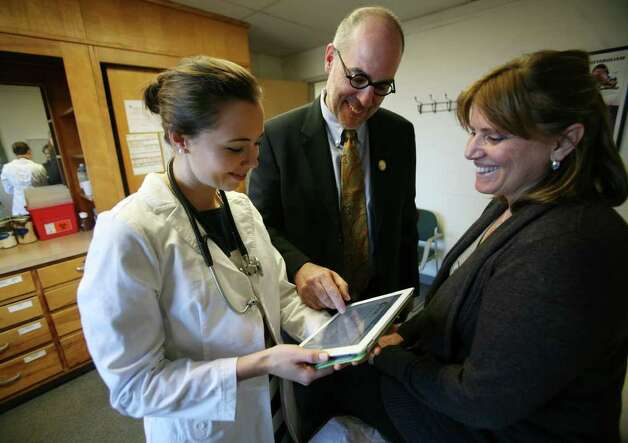 Fourth year naturopathic medicine students Kristin Tomko, left of Jericho, VT, and Maria Zangara, right of Miller Place, NY, work with Dr. Peter D'Adamo and his computer program Swami, which produces a custom diet for patient's based on their genetic characteristics at the University of Bridgeport on Thursday, February 9, 2012. D'Adamo is the director of the university's new Center of Excellence in Generative Medicine. Photo: Brian A. Pounds / Connecticut Post