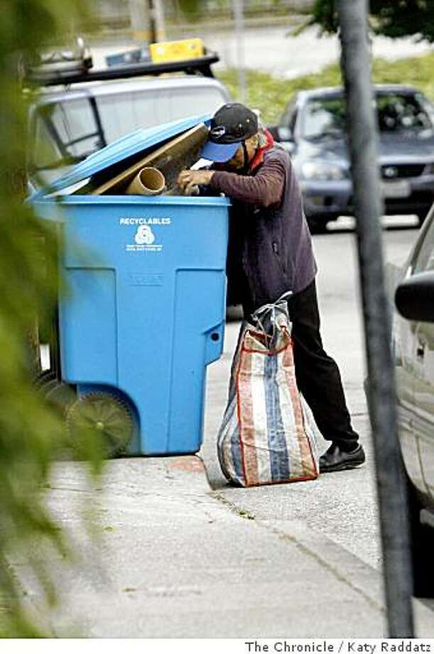 A woman picks through a recycling bin in the Glen Park neighborhood in San Francisco, Calif. on Sunday, June 29, 2008. Individuals gathering recyclables from residential bins are fairly common and haven't necessarily created controversy. However, larger, organized crews have drawn noise, litter and trespassing complaints in recent years. Photo: Katy Raddatz, The Chronicle