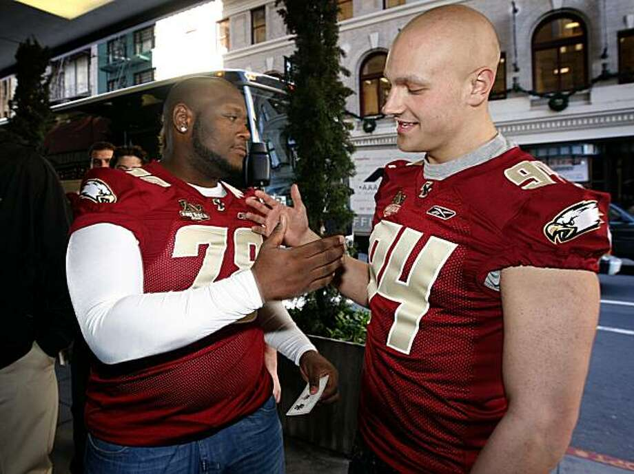 Boston College Eagles linebacker Mark Herzlich (right) and teammate Thomas Claiborne shake hands as the team arrives at the Westin Saint Francis Hotel for the annual Emerald Bowl luncheon in San Francisco, Calif., on Wednesday, Dec. 23, 2009. Herzlich spent the past season on the bench after he was diagnosed with a rare form of cancer, Ewing's sarcoma, and receiving chemotherapy treatments. Photo: Paul Chinn, The Chronicle