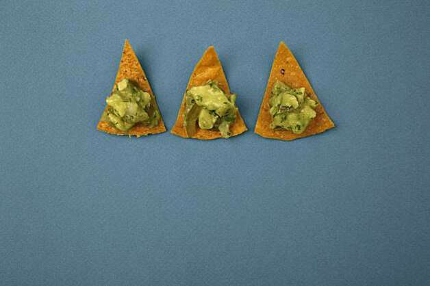 Homemade Tortilla Chips with Tomatillo Guacamole in San Francisco, Calif., on December 3, 2009. Food styled by Kalena Ross and Sarah Fritsche. Photo:  Craig Lee,  Special To The Chronicle