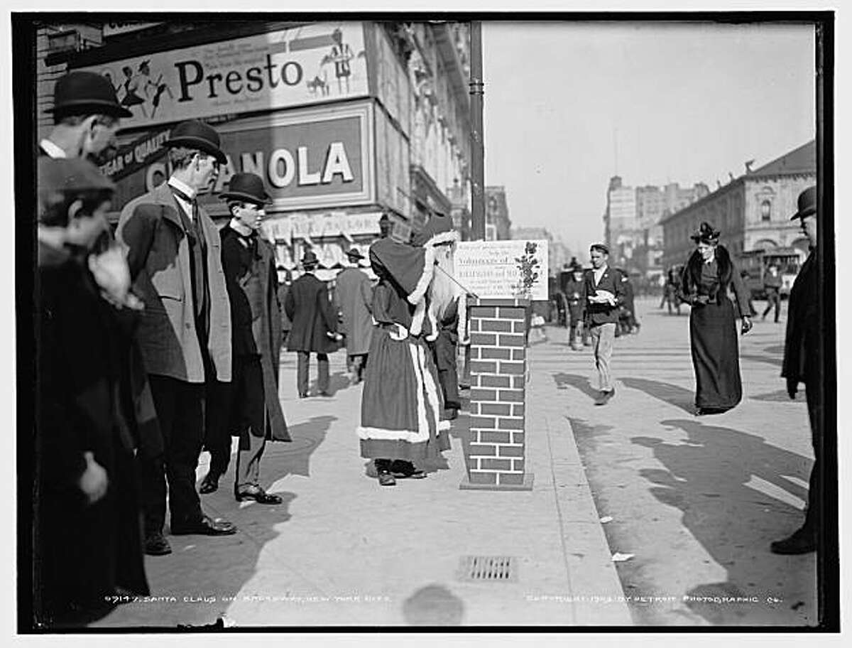 Santa Claus greeted pedestrians on Broadway in New York in 1903.