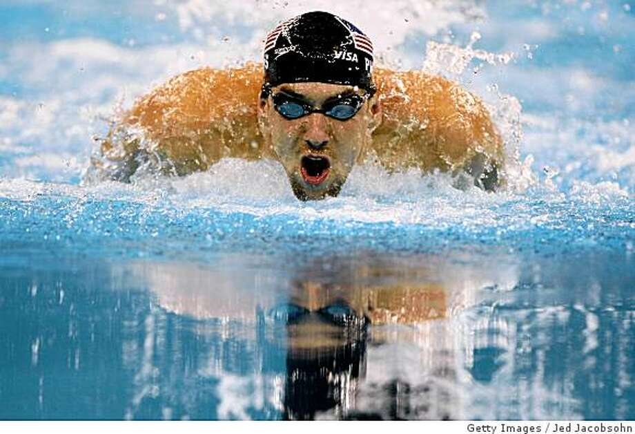 OMAHA, NE - JUNE 06:  Michael Phelps of the USA swims in the final of the 100m breaststroke during day 2 of the Mutual of Omaha Swimvitational at the Qwest Center June 6, 2008 in Omaha, Nebraska.  (Photo by Jed Jacobsohn/Getty Images) Photo: Getty Images