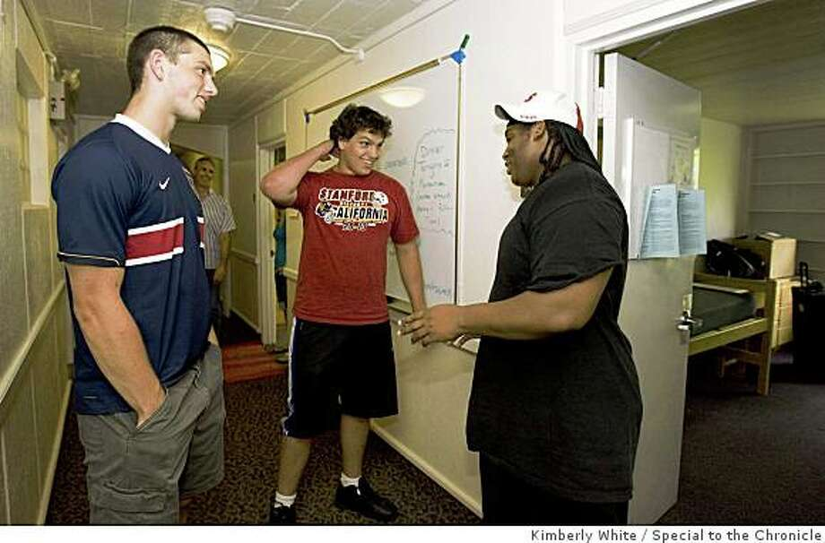 Freshman quarterback football player Andrew Luck (L) talks with fellow teammates Padric Scott (R) and Sam Schwartzstein as they move into their dormitory rooms for summer school at Stanford University in Palo Alto, California, June 21, 2008. Kimberly White/Special to the Chronicle Photo: Kimberly White, Special To The Chronicle