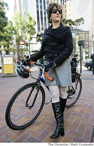 judy b. (cq and all lower case),  who bikes to work is with her bike on Market St. in San Francisco, Calif. on Tuesday, June 25, 2008.  Photo by Mark Costantini  /  The Chronicle. Photo: Mark Costantini, The Chronicle