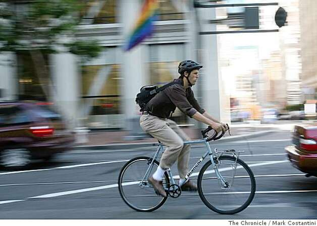 A man in slacks rides his bike on Market St. in San Francisco, Calif. on Tuesday, June 25, 2008.  Photo by Mark Costantini  /  The Chronicle. Photo: Mark Costantini, The Chronicle