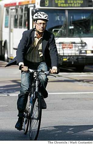 A man in a sport coat rides his bike on Market St. in San Francisco, Calif. on Tuesday, June 25, 2008.  Photo by Mark Costantini  /  The Chronicle. Photo: Mark Costantini, The Chronicle