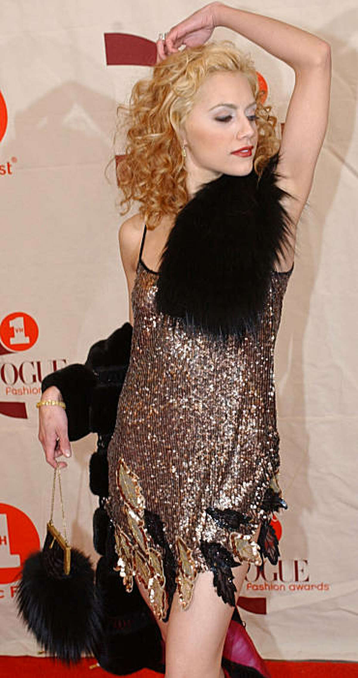 FILE - In this Oct. 15, 2002 file photo, actress Brittany Murphy arrives for the 2002 VH1/Vogue Fashion Awards at New York's Radio City Music Hall. A Los Angeles hospital spokeswoman says actress Brittany Murphy has died. She was 32. (AP Photo/Suzanne Plunkett, File)