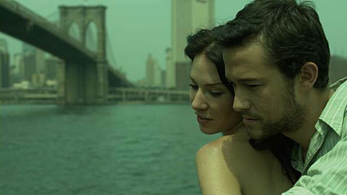 Lynn Collins as Kate Montero and Joseph Gordon-Levitt as Bobby Thompson in UNCERTAINTY directed by Scott McGehee and David Siegel.