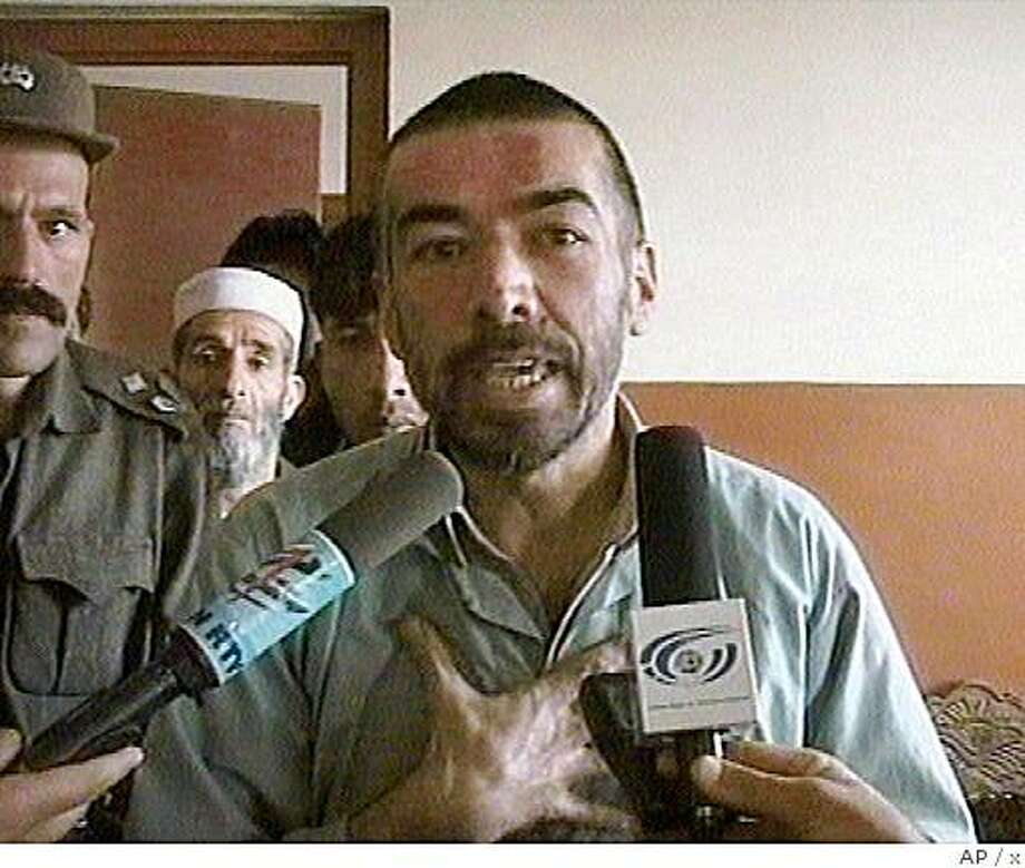 Abdul Rahman, an Afghan man who converted from Islam to Christianity, is interviewed during a hearing in Kabul on March 16, 2006 in this image made available from tv footage on Sunday, March 26, 2006. Rahman who faced a possible death sentence for converting from Islam to Christianity is to be freed after a court Sunday dismissed the case against him, citing a lack of evidence, officials said. (AP Photo/ Ariana Television via AP Television News Photo: X, AP