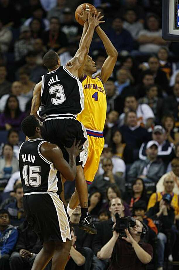 Warriors' Anthony Randolph (right) goes up for a basket while George Hill (upper right) tries to stop him during the game against the San Antonio Spurs in Oakland, Calif. on Wednesday December 16, 2009. Photo: Lea Suzuki, The Chronicle