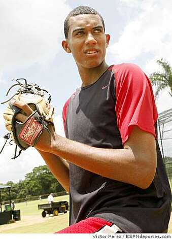 16-year-old right-handed pitcher Dominican Republic pitcher Michael Inoa signed with the Oakland Athletics for $4.4 million. The 6-foot-7 pitcher's signing is a result of Oakland's plan to increase international scouting. Photo Courtesy of Victor Perez / ESPNdeportes.com Photo: Victor Perez, ESPNdeportes.com