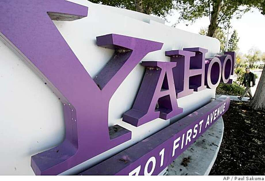 A sign outside Yahoo headquarters in Sunnyvale, Calif. is seen Wednesday, July 2, 2008.  Yahoo Inc. shares rose more than 5 percent Wednesday as The Wall Street Journal reported Microsoft Corp. has talked to other media companies about teaming up to buy Yahoo's search business. (AP Photo/Paul Sakuma) Photo: Paul Sakuma, AP