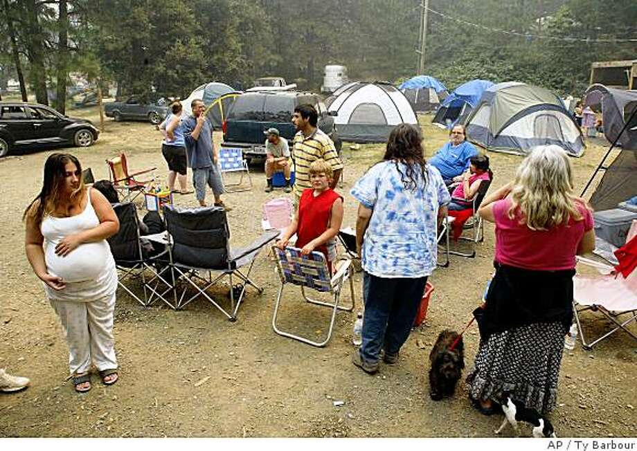 """More than 58 people set up a make shift evacuation center behind the Dome Store due to the fires caused by lightning Tuesday, June 24, 2008 in Butte Coundy, CA. In less than a day, an electrical storm unleashed nearly 8,000 lightning strikes that set more than 800 wildfires across Northern California _ a rare example of """"dry lightning"""" that brought little or no rain but plenty of sparks to the state's parched forests and grasslands. (AP Photo/Ty Barbour - Chico Enterprise Record) Photo: Ty Barbour, AP"""