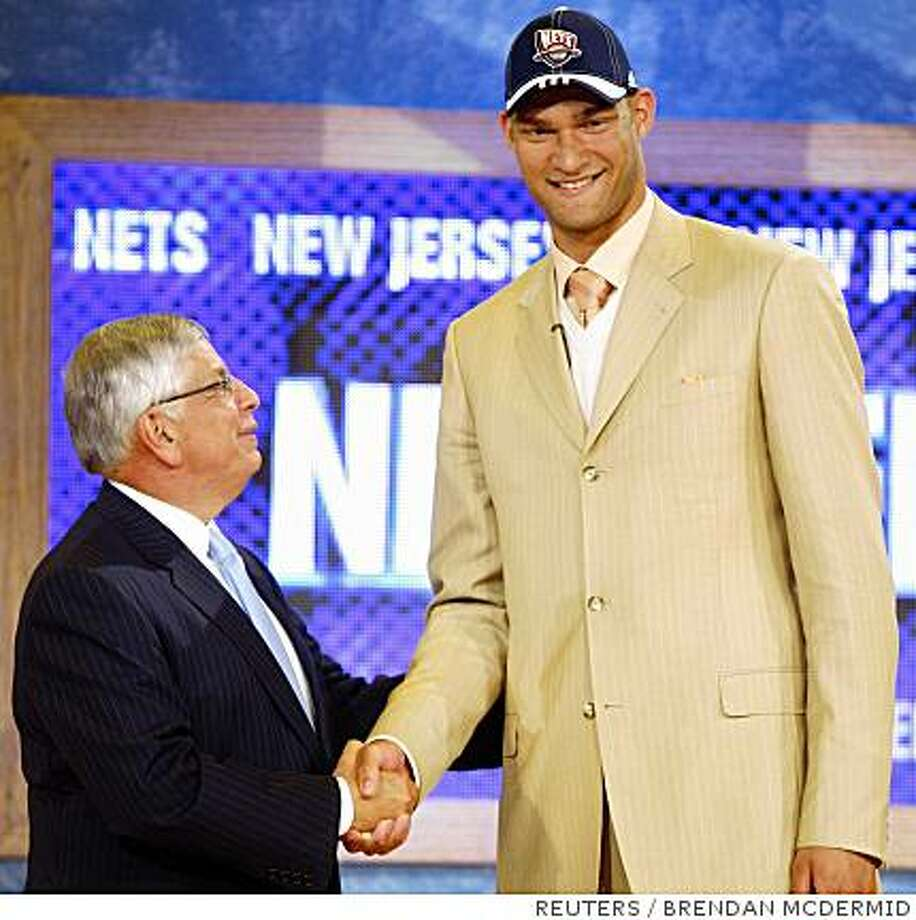 Brook Lopez shakes hands with NBA Commissioner David Stern after being selected as the 10th overall pick by the New Jersey Nets in the 2008 NBA Draft at Madison Square Garden in New York, June 26, 2008.     REUTERS/Brendan McDermid (UNITED STATES) Photo: BRENDAN MCDERMID, REUTERS