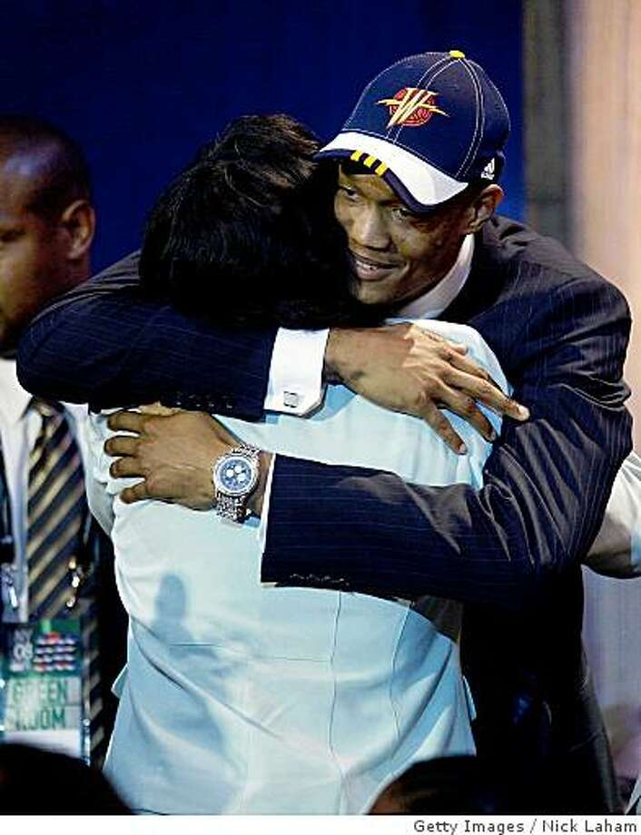 NEW YORK - JUNE 26:  Number fourteen draft pick for the Golden State Warriors, Anthony Randolph is congratulated by members of his entourage during the 2008 NBA Draft at the Wamu Theatre at Madison Square Garden June 26, 2008 in New York City. NOTE TO USER: User expressly acknowledges and agrees that, by downloading and or using this photograph, User is consenting to the terms and conditions of the Getty Images License Agreement.  (Photo by Nick Laham/Getty Images) Photo: Nick Laham, Getty Images