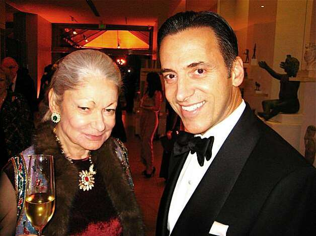Denise Hale and show sponsor Dr. Alan Malouf at the Cartier in America exhibition at the Legion of Honor. December 2009 Photo: Catherine Bigelow, Special To The Chronicle