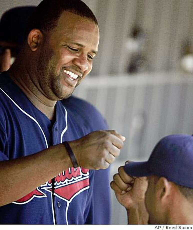 Cleveland Indians starting pitcher C.C. Sabathia, top, is congratulated in the dugout in the middle innings of an interleague baseball game against the Los Angeles Dodgers in Los Angeles, Saturday, June 21, 2008.  (AP Photo/Reed Saxon) Photo: Reed Saxon, AP