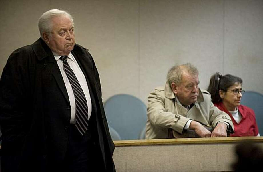 Gilbert Maines, left, the attorney representing Nancy Garrido, right, stands somewhat near his client, right, in El Dorado Superior Court in Placerville, California, Friday, December 11, 2009. Stephen Tapson, center, is now the interim attorney for Nancy Garrido until the matter is settled in appeals court. Garrido is accused of taking part in the kidnapping of Katie Callaway in 1976. (Randy Pench/Sacramento Bee/MCT) Photo: Randy Pench, MCT