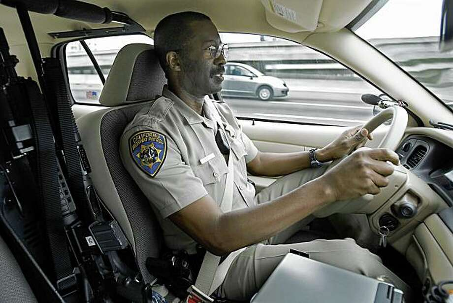 Sam Morgan an officer with the California Highway Patrol drives on highway 80 east bound through Berkeley looking for people talking on their cell phones without a hands free device on Tuesday, July 1, 2008 in Berkeley , Calif. Photo by Kurt Rogers / The Chronicle. Photo: Kurt Rogers, The Chronicle