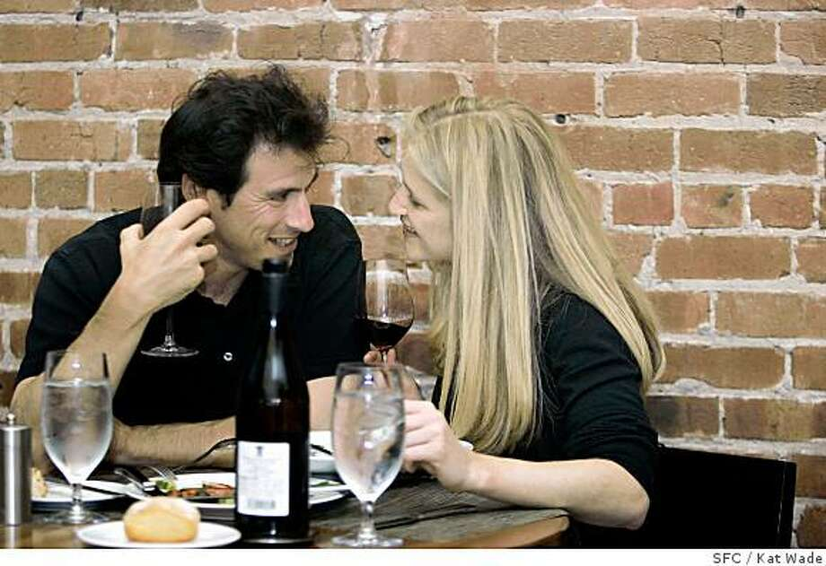 On May 23, 2007, (L to R) Robert Mason and Jordyan (CQ) Edmiston enjoy food and drink in front of the exposed brick wall at Perbacco, an Italian restaurant and bar in the financial district on California Street which has been open for seven months and has a separate and distinct bar food menu. Photo: Kat Wade, SFC