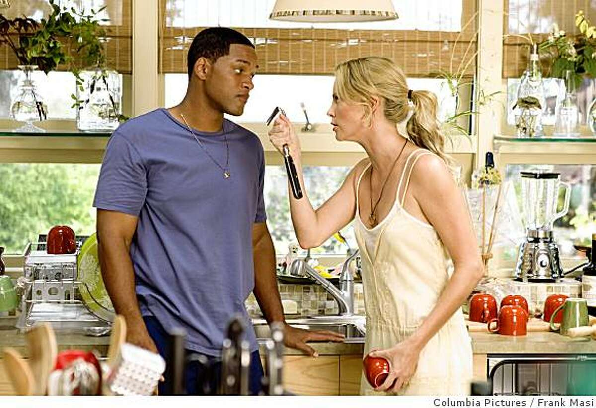 In this image released by Columbia Pictures, Will Smith, left, and Charlize Theron are shown in a scene from the film,