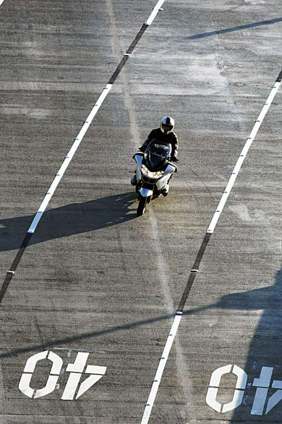A motorcyclist approaches the Bay Bridge's new 40 miles-per-hour speed zone on the upper deck.