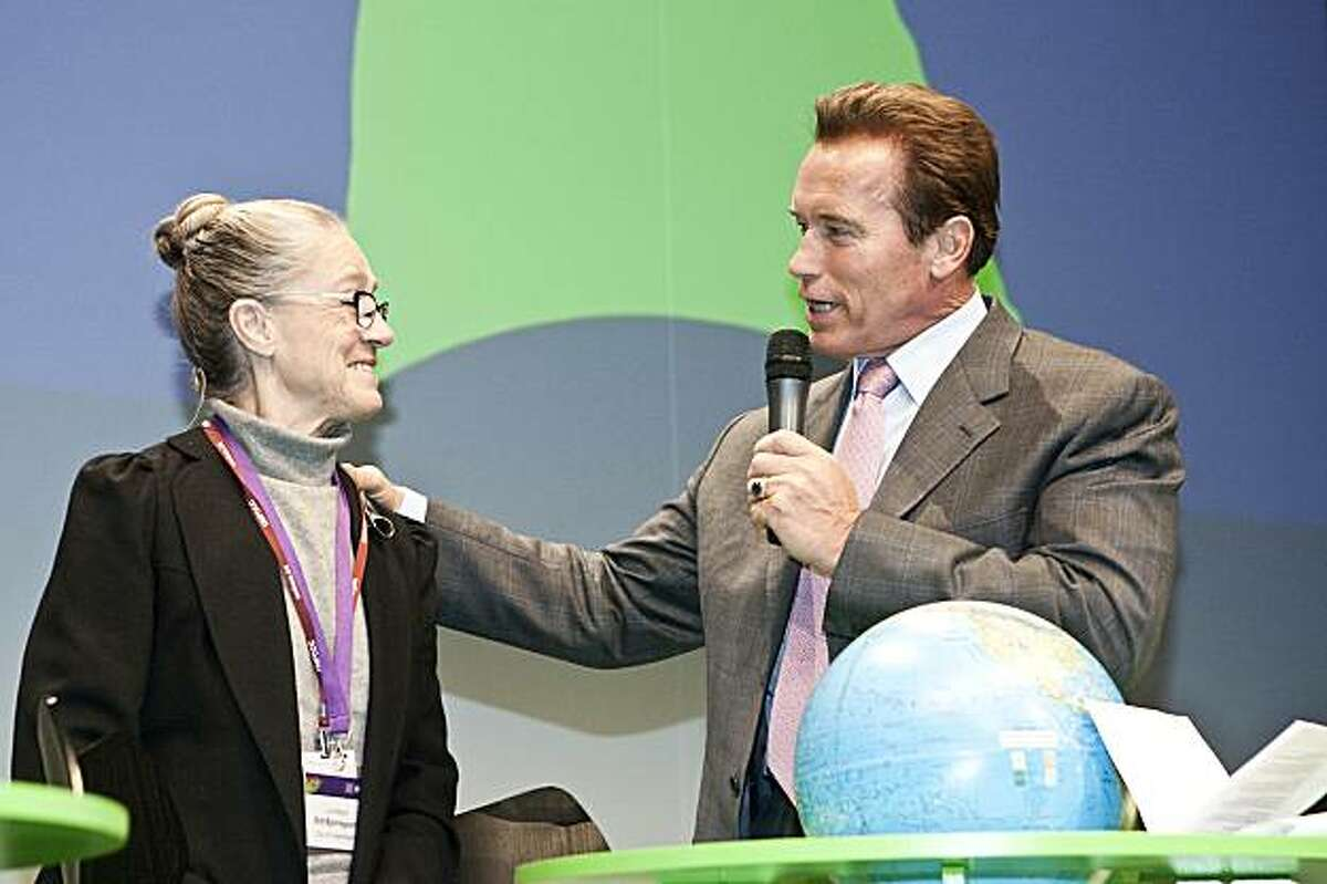 Arnold Schwarzenegger, governor of the state of California and Copenhagen Lord Mayor Ritt Bjerregaard attend a debate at the Climate Summit for Mayors at the Copenhagen City Hall Wednesday.