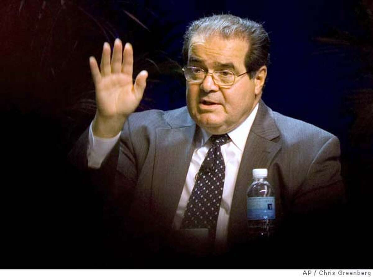 ** FILE ** Supreme Court Associate Justice Antonin Scalia gestures while speaking at the ACLU Membership Conference in Washington is this Oct., 15, 2006 file photo. (AP Photo/Chris Greenberg, File) Ran on: 02-21-2008 Justice Antonin Scalia said Congress' concern for those injured by FDA- approved devices was outweighed by its solicitude for those who would suffer without new medical devices if juries applied the (injury) law of 50 states to all innovations.