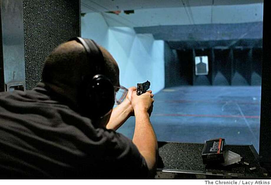 Marc Paschke shoots a his target with his Kimber 45 at the Bullseye shooting range, Thursday June 26, 2008, in San Rafael, Calif.The Supreme Court made a decision allowing people to keep guns for personal use.Photo by Lacy Atkins /The Chronicle Photo: Lacy Atkins, The Chronicle