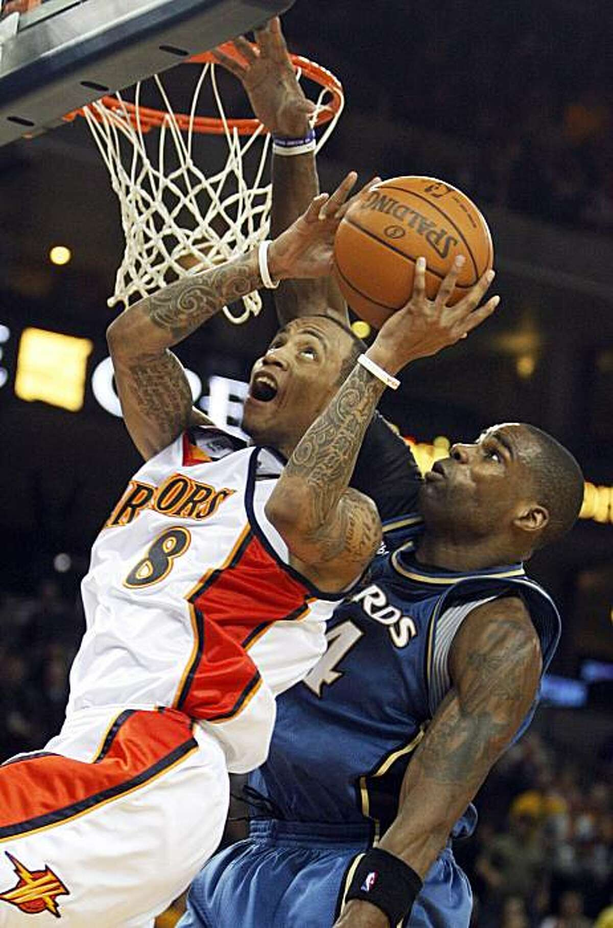 Golden State Warriors' Monta Ellis (8) goes up for a shot against Washington Wizards' Antawn Jamison during the second half of an NBA basketball game Friday, Dec. 18, 2009, in Oakland, Calif. (AP Photo/Ben Margot)