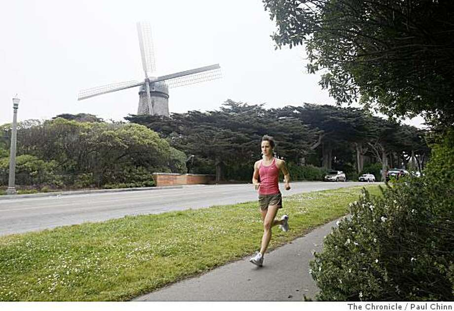 Shannon Rowbury runs past the Dutch windmill during a workout at Golden Gate Park in San Francisco, Calif., on Friday, June 13, 2008. Rowbury, a San Francisco native, is hoping to make the U.S. Olympic track and field team in the 1,500 meter event.Photo by Paul Chinn / The Chronicle Photo: Paul Chinn, The Chronicle