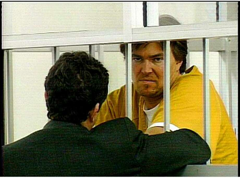Assistant public defender Michael Kotin talking to Edward Wycoff, who is behind bars. Photo: Courtesy Of KPIX, SFC