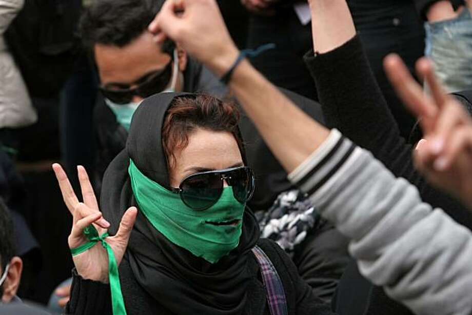 An Iranian opposition supporter gestures as she takes part in an anti-government demonstration at Tehran University in the Iranian capital on December 7, 2009. Iranian police firing tear gas clashed with crowds of protesters in central Tehran as opposition supporters used Students Day commemorations to stage fresh anti-government demonstrations. AFP PHOTO/STR (Photo credit should read -/AFP/Getty Images) Photo: -, AFP/Getty Images