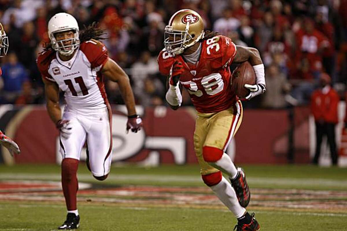 Larry Fitzgerald from Arizona Cardinals with Dashon Goldson from San Francisco 49ers during a game on Monday, December 14, 2009. San Francisco, Calif.