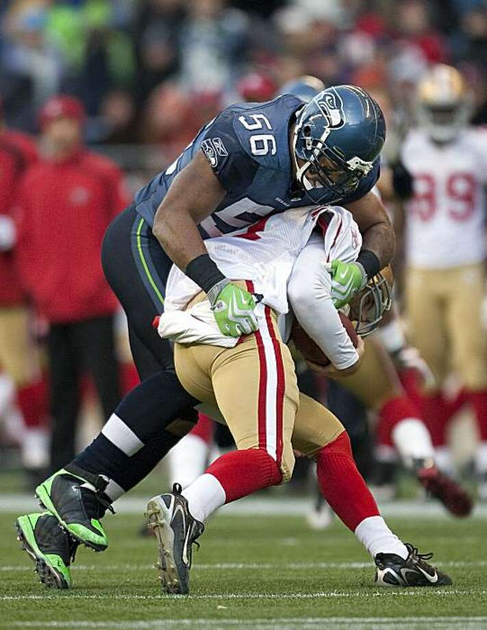 Seattle Seahawks' Leroy Hill tackled San Francisco quarterback Alex Smith in the second half. The Seahawks defeated the Niners, 20-17, in Seattle, Washington, Sunday, December 6, 2009. (Dean Rutz/Seattle Times/MCT) Photo: Dean Rutz, MCT