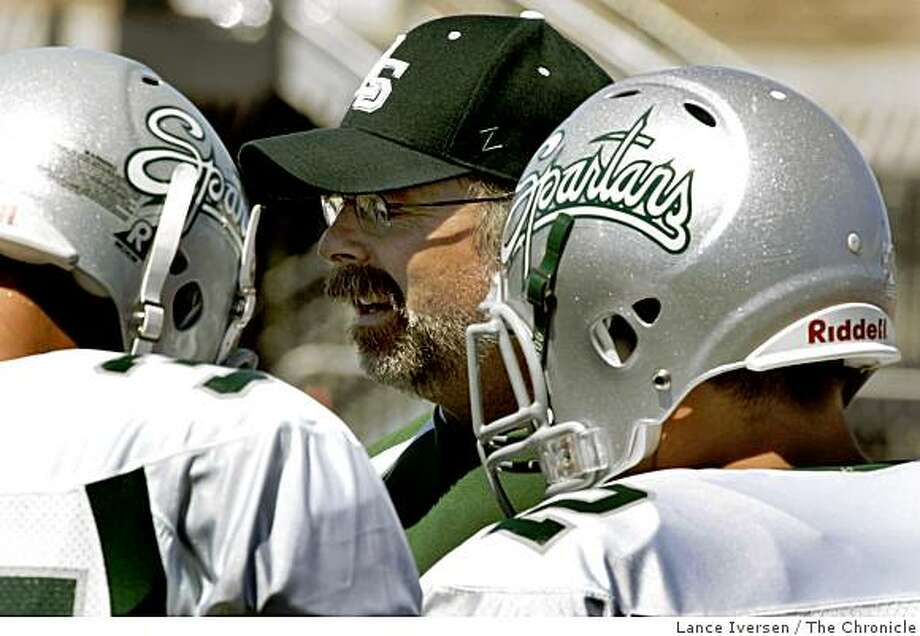 De La Salle Varsity asst coach Terry Eidson talks with two members of the team peior to De La Salle Vs. Serra High School game .SEPTEMBER 9, 2006 in SAN MATEO.  By Lance Iversen/San Francisco Chronicle Photo: Lance Iversen, The Chronicle
