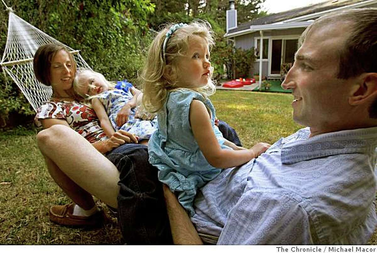 Mike and Sarah Northrop at their Pacifica, Calif. home with their daughters Sylvanna, 4, with mom, and Nerea, 2, with dad, on June 13, 2008. After renting a home in San Francisco for seven years the family moved to Pacifica because they couldn't find a home they could afford to buy with enough room for the four of them.Photo By Michael Macor/ The Chronicle